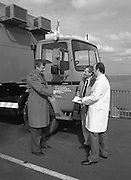 B.I.M.Training Vehicle.  (R31)..1986..11.04.1986..04.11.1986..11th April 1986..B.I.M's Coastal training unit left Ireland today to visit the major fishing ports of Brittany. Over the next three weeks demonstrations will be given, to French fishermen, of the types of courses provided by the board for fishermen at their home ports. Staffed by two instructors the unit offers comprehensive courses in navigation,radiotelephony, engine maintenance, electrical systems,Hydraulics and refrigeration. This endeavour is funded by the E.E.C. Commission...Image shows (L-R) Dr Tony Meaney, Chief Executive,B.I.M.,wishing instructors Tom Kelly and Declan O'Connor bon voyage as they set off for France.