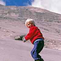 Ben Wiltsie, age 4, scrambles up glacier-polished rock in California's Yosemite National Park.