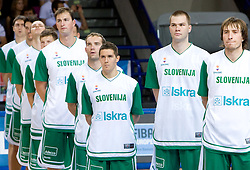 Primoz Brezec (7) of Slovenia, Samo Udrih (6) of Slovenia, Jaka Lakovic (5) of Slovenia, Uros Slokar (4) of Slovenia, Matjaz Smodis (8) of Slovenia  listening to the national anthem before  the basketball match at Preliminary Round of Eurobasket 2009 in Group C between Slovenia and Spain, on September 09, 2009 in Arena Torwar, Warsaw, Poland. Spain won 90:84 after overtime. (Photo by Vid Ponikvar / Sportida)