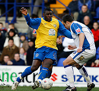 Photo: Paul Greenwood.<br />Tranmere Rovers v Hereford City. FA Cup Third Round. 05/01/2008. <br />Hereford's Trevor Benjamin (L) takes on Antony Kay