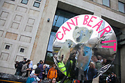 Outside Shell's London HQ. The giant polar bear puppet Aurora made by Greenpeace walks the streets of London in defence of the Arctic as part of a Greenpeace global day of action. The parade,part performance part protest, was to highlight the melting ice caps and the increasing and potentially devastating oil drilling in the arctic sea. Shell is one of the companies drilling and the march through London ended up outside Shell London HQ to draw attention to their oil business in the arctic. Aurora, the biggets polar bear in the world represents all endangered species in arctic.