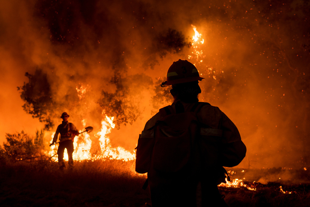 Members of the Grizzly Firefighters fight the Carmel Fire in Cachagua, Calif. on Aug. 18, 2020.