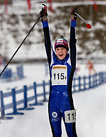 Langrenn - Junior NM Stafett - Holmenkollen 3. mars 2002 -  Berthe A. Svenkerud, Hedmark jubler for en fin andre plass. (Foto: Andreas Fadum, Digitalsport)