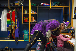 """Ringmaster Johnathan Lee Iverson, 39, gives his daughter Lila, 6, a kiss in his dressing room before a performance. Johnathan Lee Iverson made history at only 22 years old, when he became the youngest, the first New Yorker, and the first African American ringmaster in the nearly 140 year history of Ringling Bros. and Barnum & Bailey circus. <br /> <br /> Ringling Bros. and Barnum & Bailey Circus started in 1919 when the circus created by James Anthony Bailey and P. T. Barnum merged with the Ringling Brothers Circus. Currently, the circus maintains two circus train-based shows, the Blue Tour and the Red Tour, as well as the truck-based Gold Tour. Each train is a mile long with roughly 60 cars: 40 passenger cars and 20 freight. Each train presents a different """"edition"""" of the show, using a numbering scheme that dates back to circus origins in 1871 — the first year of P.T. Barnum's show."""