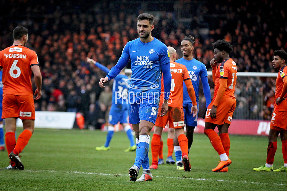 Peterborough Utd defender Ryan Tafazolli (5) walking off after his red card during the EFL Sky Bet League 1 match between Luton Town and Peterborough United at Kenilworth Road, Luton, England on 19 January 2019.