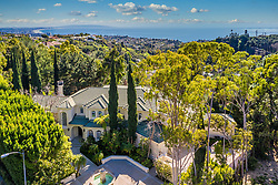 EXCLUSIVE: Prince Harry and Meghan Markle are eyeing-up this stunning Mediterranean-style villa in California's wealthy Pacific Palisades neighborhood. The six-bedroom, six-bathroom 6,185sqft property is set over 1.2 acres of flat expansive lawns and boasts both unobstructed ocean and mountain views. Complete with all the luxurious trappings — including pool, children's play area, gourmet chef's kitchen and home theater — the property is the epitome of indoor-outdoor California living at its finest, and is on the market for $14,950,000. According to sources, the Sussexes are close to signing a deal on the house, which is currently owned by Fast and Furious producer Steven Chasman and his wife Nadia Fares, a French actress. If the purchase goes ahead, the Sussexes will be able to count the likes of Tom Hanks and Ben Affleck as their neighbors. They are also said to be planning to have Meghan's mother Doria move in with them and baby Archie. A source revealed: 'Once quarantine and lockdown are over, Harry and Meghan will be moving into their new pad - and they want Doria to be included in these plans. 'She is hugely independent though, and doesn't want to be in their space. She will have her own granny annex.' The stunning photographs of the property also reveal beautiful interiors, including panoramic floor-to-ceiling glass doors in the master suite, providing beautiful ocean views. There is also a grand pergola and modern swimming pool, as well as an outdoor play area for little Archie. Meghan and Harry moved to Canada after stepping down as senior royals earlier this year, but flew to California in March just before the borders closed due to the coronavirus pandemic. They are currently believed to be renting a Los Angeles home near to Elton John and David Furnish, who they are said to be in regular contact with. The Pacific Palisades property they are eyeing up initially went on the market back in September and the listing is now held by Steve Sawai