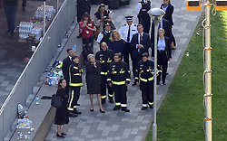 Prime Minister Theresa May visits the scene near Grenfell Tower in west London after a fire engulfed the 24-storey building yesterday morning.