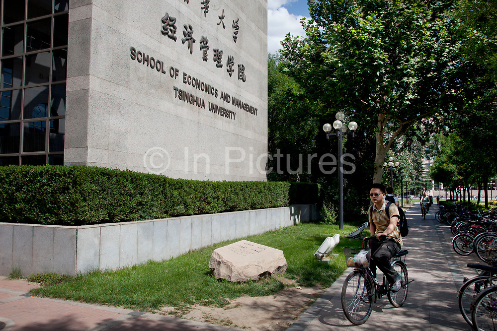 Students cycling past the central main building on campus at Tsinghua University in Beijing, China. The school is one of the nine universities of the C9 League. It was established in 1911 under the name 'Tsinghua Xuetang'. The university section was founded in 1925 and the name 'National Tsinghua University' started in 1928. With a motto of Self-Discipline and Social Commitment, Tsinghua University describes itself as being dedicated to academic excellence, the well-being of Chinese society and to global development. Tsinghua is almost always ranked as the first or second best university in mainland China in many national and international rankings. According to the Times Higher Education World University Rankings 2011–2012, Tsinghua ranked 71 worldwide among universities.