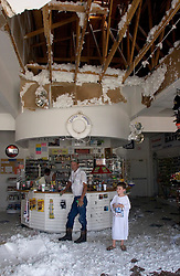 25 Sept 2005, Carlyss, Louisiana.  Hurricane Rita aftermath. <br /> Local cajun man Harold Herman (behind counter) opens Bayou Landing, his convenience store to neighbours, despite the collapsed ceiling to keep people in basic food and supplies. <br /> Photo; ©Charlie Varley/varleypix.com