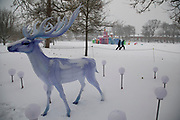 Deer illuminations in Kings Heath Park after heavy snow fall on Sunday 10th December 2017 in Birmingham, United Kingdom. Deep snow arrived in much of the UK, closing roads and making driving treacherous, while many people simply enjoyed the weather.