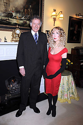RICHARD and BASIA BRIGGS at a birthday party they hosted for Lady Meyer at their home 25 Sloane Gardens, London SW1 on 28th January 2009.