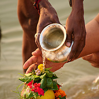 Preparing an offering for the Ganges.