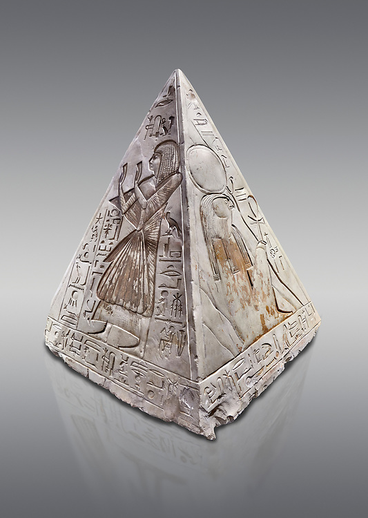 """Ancient Egyptian Pyramidion of Ramose North & East sides, Limestone, New Kingdom, 19th Dtnasty (1292-1190 BC), Dier el-Medina. Egyptian Museum, Turin. Old Fund cat 1603. Grey background.<br /> <br /> The north face of the Ramose Pyramidion explains the attribute of Horus as the strong coronal electric field of the Sun gifting the Ankh as a support to Life. It reads """"Strong coronal electric field supporting the Sun, negative charge induction."""""""" Weak electric field is an attribute of the anode Sun.""""""""Electricity supporting life to core charge store God"""".<br /> <br /> The east face of the Ramose Pyramidion shows the support for the structured plasma, her hands are held up representing the electric force on the perpendicular face to the North South axis of Horus, the strong coronal electric field. It reads"""" Structured plasma watched, attribute supporting life projecting power (negative charge) to support charge store (celestial body) electrostatic resonance."""""""" Seek home structured plasma to land negative charge projection by God as lightning attribute support celestial body via connection giving movement and [light].""""<br /> <br /> The limestone Pyramidion of Ramose, from the top of the tomb of the 'Necropolis Scribe'. Scenes on all four sides depict the worship of the sun. .<br /> <br /> If you prefer to buy from our ALAMY PHOTO LIBRARY  Collection visit : https://www.alamy.com/portfolio/paul-williams-funkystock/ancient-egyptian-art-artefacts.html  . Type -   Turin   - into the LOWER SEARCH WITHIN GALLERY box. Refine search by adding background colour, subject etc<br /> <br /> Visit our ANCIENT WORLD PHOTO COLLECTIONS for more photos to download or buy as wall art prints https://funkystock.photoshelter.com/gallery-collection/Ancient-World-Art-Antiquities-Historic-Sites-Pictures-Images-of/C00006u26yqSkDOM"""