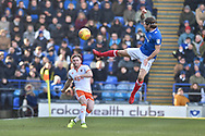 Blackpool Defender, Oliver Turton (20) closed down by Portsmouth Midfielder, Matty Kennedy (11) during the EFL Sky Bet League 1 match between Portsmouth and Blackpool at Fratton Park, Portsmouth, England on 24 February 2018. Picture by Adam Rivers.