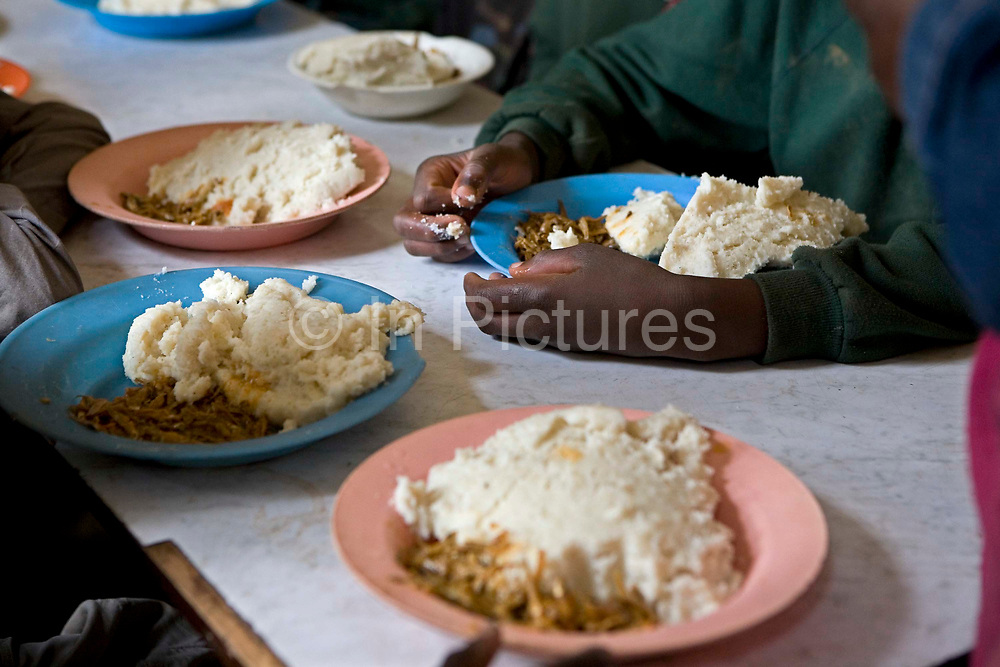 Dinner at the Streets Ahead centre in Harare, Zimbabwe. They often serve matoke and small dried Whitebait, as it is cheap good nutritional value meal. Streets Ahead is a welfare organisation that works with underprivileged children living on the streets of Harare.