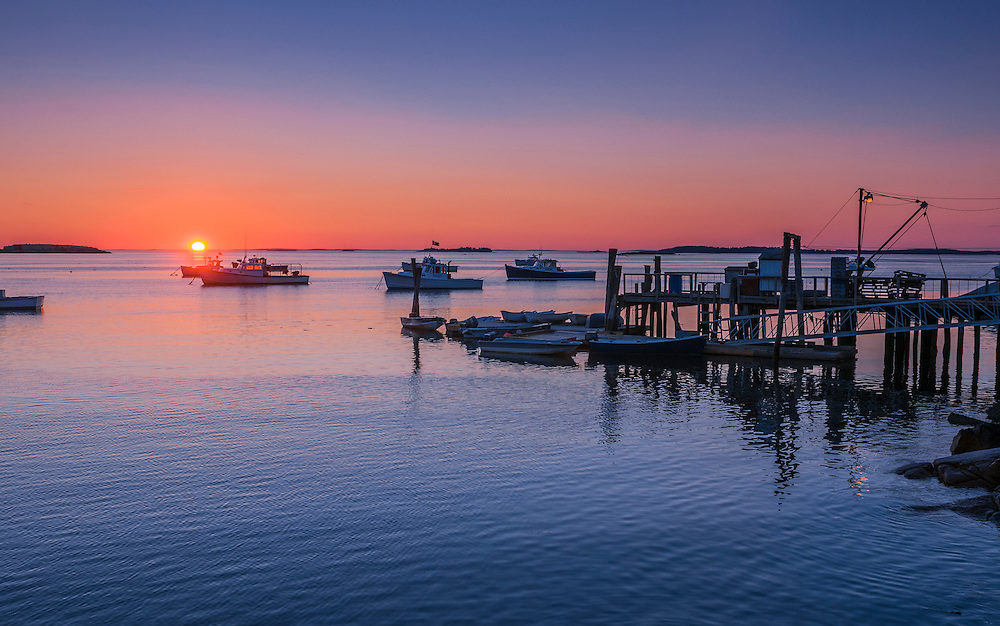 Sunrise over Mussel Ridge Channel, lobster fishing boats and pier. South Thomaston, ME