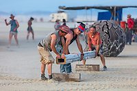 Final Touches around The Folly <br /> by: Dave Keane & The Folly Builders<br /> from: San Francisco, CA<br /> year: 2019<br /> <br /> The Folly represents an imaginary shantytown of funky climbable towers and old western storefronts, cobbled together from salvaged and reclaimed lumber from original San Francisco Victorians to be reborn in the desert, affording shelter, entertainment and perspective to the community.<br /> <br /> URL: www.thefollybrc.com<br /> Contact: info@thefollybrc.com<br /> <br /> https://burningman.org/event/brc/2019-art-installations/?yyyy=&artType=H#a2I0V000001AVkAUAW My Burning Man 2019 Photos:<br /> https://Duncan.co/Burning-Man-2019<br /> <br /> My Burning Man 2018 Photos:<br /> https://Duncan.co/Burning-Man-2018<br /> <br /> My Burning Man 2017 Photos:<br /> https://Duncan.co/Burning-Man-2017<br /> <br /> My Burning Man 2016 Photos:<br /> https://Duncan.co/Burning-Man-2016<br /> <br /> My Burning Man 2015 Photos:<br /> https://Duncan.co/Burning-Man-2015<br /> <br /> My Burning Man 2014 Photos:<br /> https://Duncan.co/Burning-Man-2014<br /> <br /> My Burning Man 2013 Photos:<br /> https://Duncan.co/Burning-Man-2013<br /> <br /> My Burning Man 2012 Photos:<br /> https://Duncan.co/Burning-Man-2012