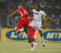 Photo: Steve Bond/Richard Lane Photography.<br />Ghana v Namibia. Africa Cup of Nations. 24/01/2008. Eric Addo (R) and Muna Katupos (L) clash in the air