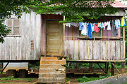 A typical clapboard house with multi coloured washing hanging on the line to dry, Principe, Sao Tome and Principe<br /> Sao Tome and Principe, are two islands of volcanic origin lying off the coast of Africa. Settled by Portuguese convicts in the late 1400s and a centre for slaving, their independence movement culminated in a peaceful transition to self government from Portugal in 1975.