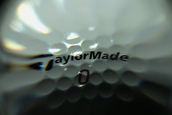 TaylorMade golf ball behind 104mm glass sphere in dark box with strobe lighting