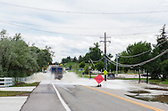 September 13, 2013: Alkire Street in Arvada, CO disappears under water as a small creek overflows its banks after record breaking rains hit Colorado over the last few days