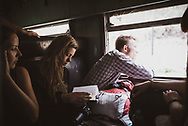 Travelers from Denmark and other countries ride a train on the several-hour journey from Nuwara Eliya to Ella, Sri Lanka.  (April 9, 2017)