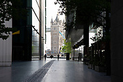 More London looking towards Tower Bridge which is normally bustling with tourists is eerily quiet and silent on empty streets as lockdown continues and people observe the stay at home message in the capital on 11th May 2020 in London, England, United Kingdom. Coronavirus or Covid-19 is a new respiratory illness that has not previously been seen in humans. While much or Europe has been placed into lockdown, the UK government has now announced a slight relaxation of the stringent rules as part of their long term strategy, and in particular social distancing.