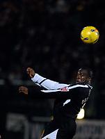 Photo: Alan Crowhurst.<br />Brighton & Hove Albion v Swansea City. Coca Cola League 1. 05/12/2006. Swansea's Adebayo Akinfenwa heads at goal.