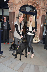 Left to right, sisters DAVINA HARBORD and ASTRID HARBORD and Guinness the dog at The Dog's Trust Awards announcement held at George, 87-88 Mount Street, London on 27th March 2012.