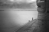 Cambodian standing along a concrete riverbed of Mekong river, Phnom Penh, Cambodia, Southeast Asia