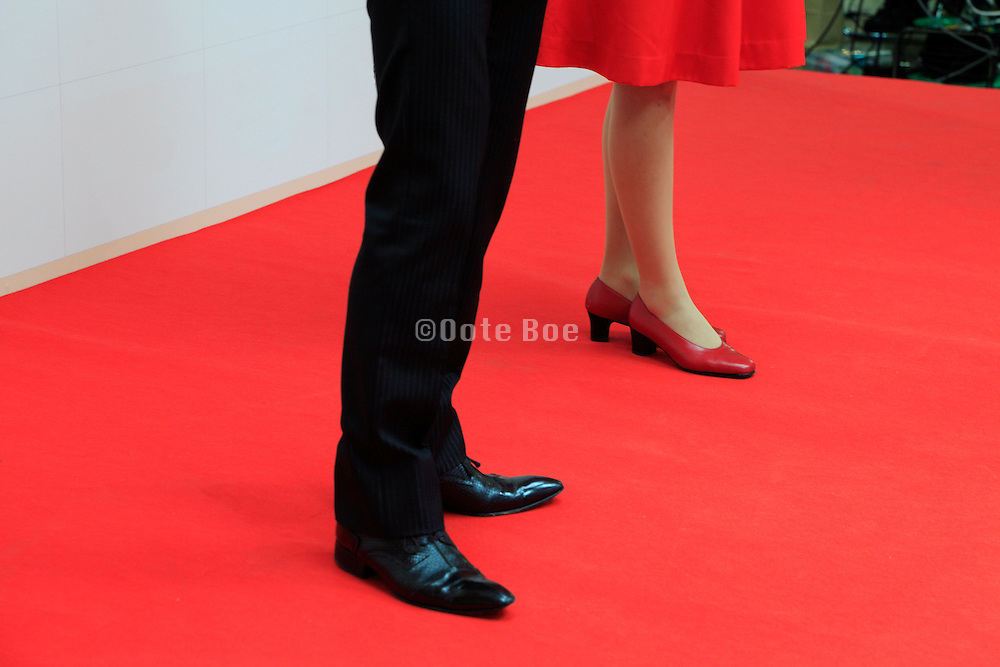 legs of female and male host on the Red Carpet