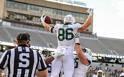 Oct 3, 2020; Morgantown, West Virginia, USA; Baylor Bears tight end Ben Sims (86) scores a touchdown and celebrates with teammates during the first overtime against the West Virginia Mountaineers at Mountaineer Field at Milan Puskar Stadium. Mandatory Credit: Ben Queen-USA TODAY Sports