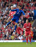 Photo: Jed Wee.<br /> Liverpool v Manchester United. The Barlcays Premiership. 18/09/2005.<br /> <br /> Manchester United's Cristiano Ronaldo (R) jumps with Liverpool's Sami Hyypia.