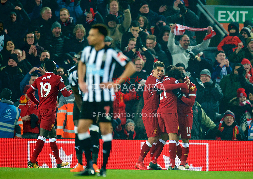 LIVERPOOL, ENGLAND - Saturday, March 3, 2018: Liverpool's Mohamed Salah celebrates scoring the first goal with team-mates during the FA Premier League match between Liverpool FC and Newcastle United FC at Anfield. (Pic by Peter Powell/Propaganda)