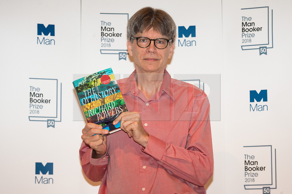 © Licensed to London News Pictures. 14/10/2018. London, UK. Author Richard Powers poses with his  book The Overstory during a photocall at the Royal Festival Hall, two days ahead of the announcement of the winning book of the 2018 Man Booker Prize. Six novelists have been shortlisted for the 2018 Man Booker Prize, a literary prize awarded for the best original novel in English credit: PhotoRay Tang/LNP