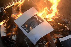 November 9, 2016 - Kolkata, West Bengal, India - Indian Prime Minister Narendra Modi picture burns during a protest against the Indian government decision to withdraw of Rs.500 and Rs. 1000 bank notes across India today in Kolkata. (Credit Image: © Saikat Paul/Pacific Press via ZUMA Wire)
