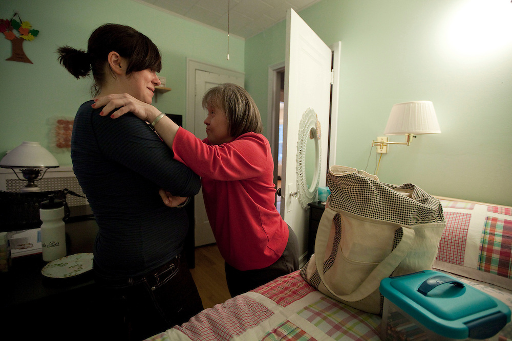 Mary Beth Solinski, a 59 year old, with Down Syndrome, hugs her niece Sarah Graziano, 22, as Solinski packs for a sleepover at Graziano's house...Aging adults with Down Syndrome. In 1983, people with Down syndrome could expect to live to age 25. Today, their life expectancy is 60 years. We interview a 59-year-old patient who has outlived her parents and is now in AARP. She has trouble walking, but has lots of interests, such as cooking, arts and crafts and reading.
