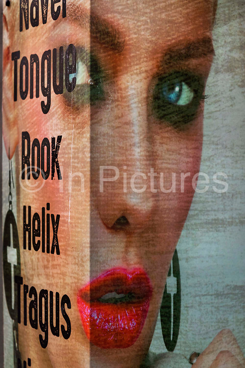 Poster of a models gaze in window of beauty parlour on 21st April 2021 in Blackpool, Lancashire, United Kingdom.