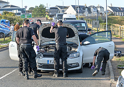 Pictured: Police searched all vehicles near the hotel.<br /> <br /> Protesters gathered amid tight security at the Trump Turnberry resort, where President Trump and his wife Melania are staying on their trip to Scotland.<br /> <br /> © Dave Johnston / EEm