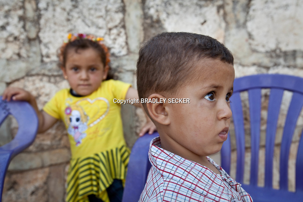 Young siblings play at  their grandparent's house in Basheria, Idlib. When the Syrian military and shabiha militiamen attacked the village on April 22nd the children's father was shot and killed as he fled into the surrounding mountains. Basheria, Idlib, Syria. 14/06/2012