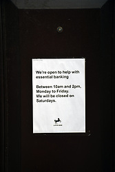 Reduced opening hours at Lloyds Bank during Coronavirus lockdown, Norwich UK April 2020
