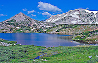 Lewis Lake below Sugarloaf Mountain (left) and Medicine Bow Peak of the Snowy Range, Wyoming.