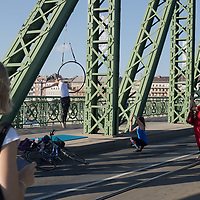 People participate a summer afternoon on a bridge closed for pedestrian traffic only in central Budapest, Hungary on July 15, 2018. ATTILA VOLGYI