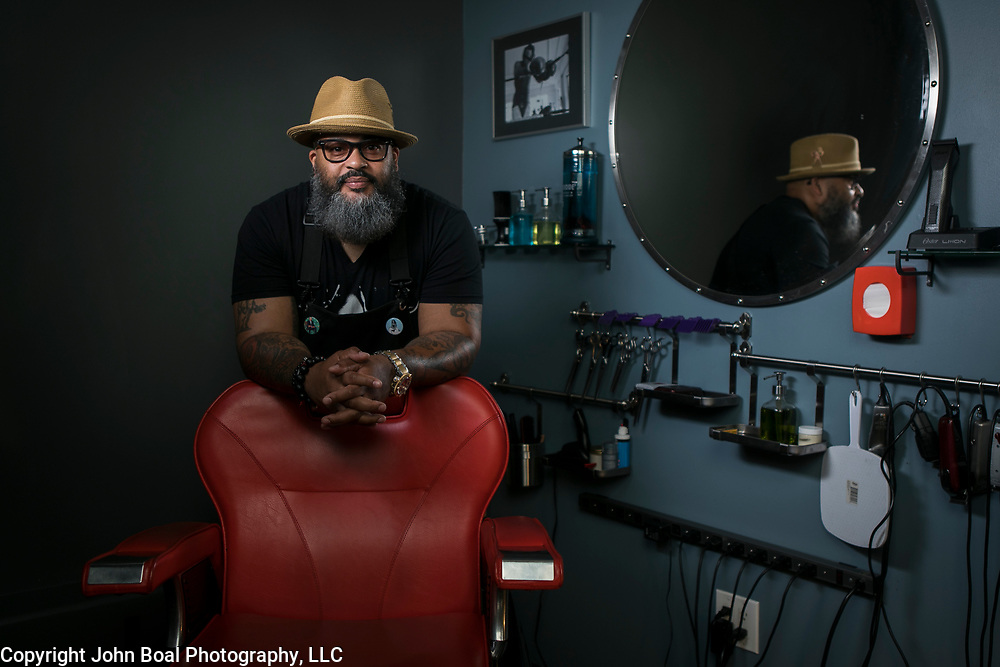 """Reggie """"Hollywood the Barber"""" Blagmon, in his studio space in Laurel, MD, on Monday, June 18, 2018. He's been a barber for 29 years, inspired by his father's style. His used to be a singer in the '70's for R&B groups, The Stridels and later, The Choice Four who had a few hits and once performed on Soul Train. John Boal Photography"""