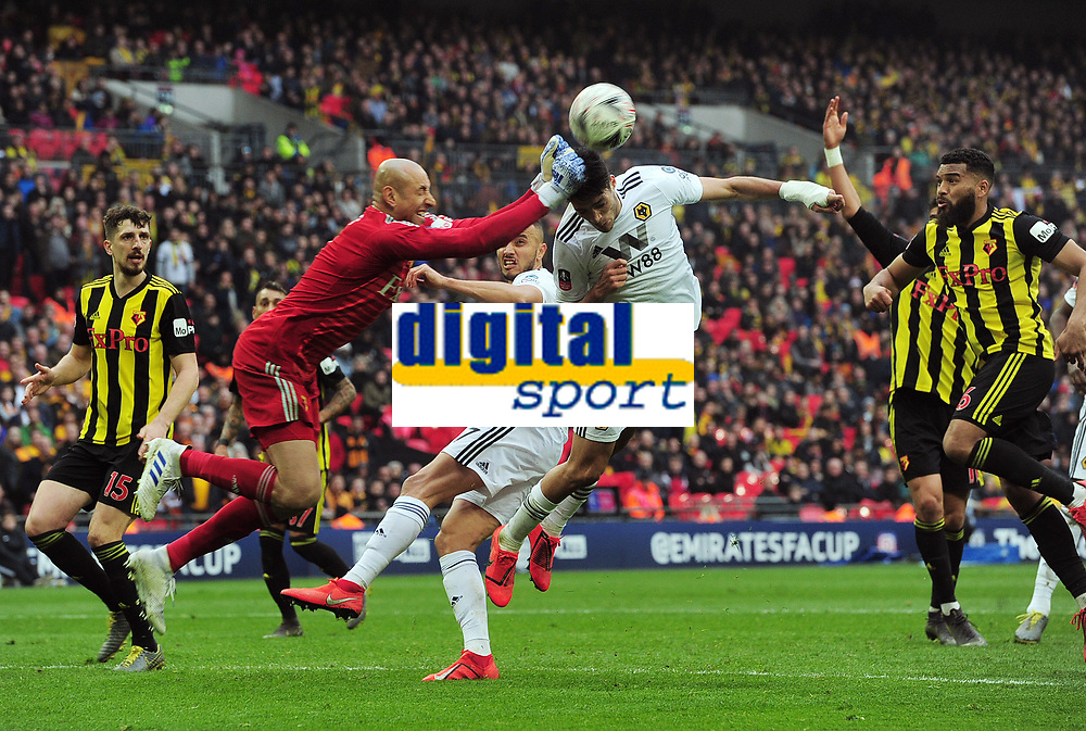 Football - 2018 / 2019 Emirates FA Cup - Semi-Final: Wolverhampton Wanderers vs. Watford<br /> <br /> Watford goalkeeper, Heurelho Gomes punches clear from the head of Raul Jimenez, at Wembley Stadium.<br /> <br /> COLORSPORT/ANDREW COWIE