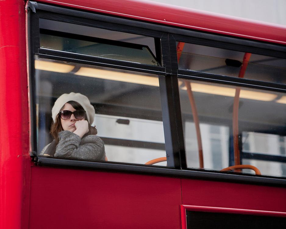 Female on a London Bus