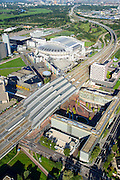 Nederland, Noord-Holland, Amsterdam, 27-09-2015; Amsterdam Zuidoost, Station Amsterdam Bijlmer Arena. Arena Boulevard en Hoekenrodeplein (bij Amsterdamse Poort) rechts. Utrechtboog en Station Duivendrecht in de verte.<br /> Railway Station Amsterdam Bijlmer Arena, near football stadion Arena of Ajax.<br /> luchtfoto (toeslag op standard tarieven);<br /> aerial photo (additional fee required);<br /> copyright foto/photo Siebe Swart