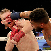 FORT LAUDERDALE, FL - FEBRUARY 15: Jim Alers (R) lands a right hand to the face of Kaleb Harris during the Bare Knuckle Fighting Championships at Greater Fort Lauderdale Convention Center on February 15, 2020 in Fort Lauderdale, Florida. (Photo by Alex Menendez/Getty Images) *** Local Caption *** Jim Alers; Kaleb Harris