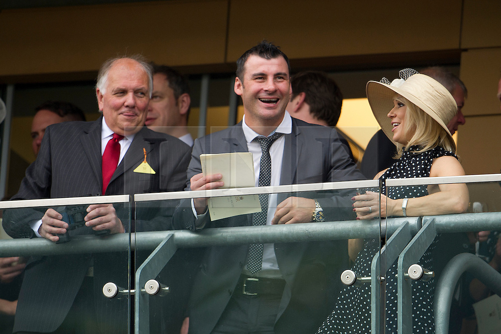 © London News Pictures. 18/06/2013. Ascot, UK.  Joe Calzaghe (centre) girlfriend Kristina Rihanoff (right)  watching a race on day one of Royal Ascot at Ascot racecourse in Berkshire, on June 18, 2013.  The 5 day showcase event,  which is one of the highlights of the racing calendar, has been held at the famous Berkshire course since 1711 and tradition is a hallmark of the meeting. Top hats and tails remain compulsory in parts of the course. Photo credit should read: Ben Cawthra/LNP