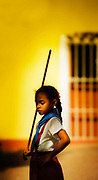 A child practices a dance with other members of her school in Trinadad, Cuba. (Photography by Jim Graham)